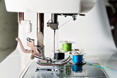Close up view of sewing machine with reels Royalty Free Stock Images