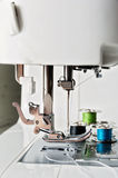 Close up view of sewing machine with reels Royalty Free Stock Photo