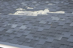 A close up view of shingles a roof damage. Roof Shingles - Roofing. stock photos