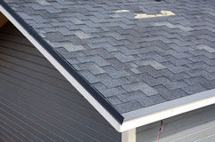 A close up view of shingles a roof damage. Roof Shingles - Roofing. Royalty Free Stock Image