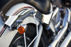 Close up view of a shiny chrome motorcycle design engine with bl. Inker Royalty Free Stock Images