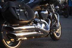 Close up view of a shiny chrome motorcycle design engine with ex Royalty Free Stock Photo