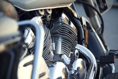 Close up view of a shiny chrome motorcycle design engine with ex Stock Image