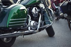 Close up view of a shiny chrome motorcycle design engine with ex Stock Photography