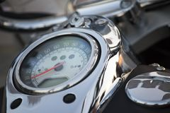 Close up view of a shiny chrome motorcycle design engine with sp. Eedometer Royalty Free Stock Photos