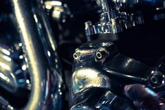 Close up view of a shiny motorcycle engine. Macro Royalty Free Stock Photos