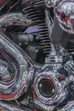 Close up view of a shiny motorcycle engine. vintage close up of motorcycle exhaust, noise. vertical photo.  stock photo