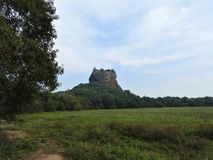 Close-up, view of Sigiriya lion mountain fortress in greenery, Sri Lanka, on a clear day.  royalty free stock photos
