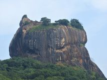Close-up, view of Sigiriya lion mountain fortress in greenery, Sri Lanka, on a clear day.  royalty free stock photo