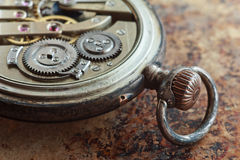 Close-up view of a silver pocket watch. Stock Images