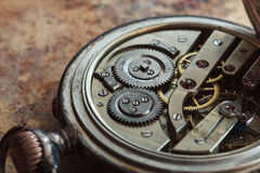 Close-up view of a silver pocket watch. Stock Image