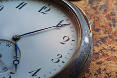 Close-up view of a silver pocket watch. Royalty Free Stock Image