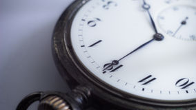 Close-up view of a silver pocket watch. Stock Photo