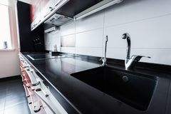 Close up view of sink and faucets. In kitchen stock photography