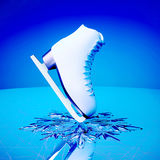 Close up view of  The skates for figure skating on skating rink ice. Royalty Free Stock Image