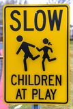 Close up view of Slow Children At Play sign. Close up view of a Slow Children At Play sign near a playground. It alerts drivers to slow down because they are stock image