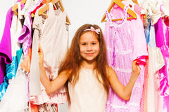 Close-up view of small girl choosing clothes Royalty Free Stock Photo