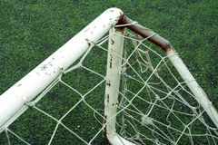Close up view of a small soccer goal with top bins and net, placed on a soccer field. Royalty Free Stock Photography