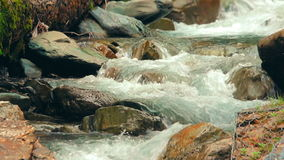 Close-up view of a small waterfalls of the tropical mountain river stock video