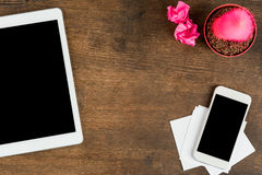 Close-up view of smartphone and digital tablet with blank screens on wooden table top Royalty Free Stock Photos