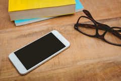 Close up view of smartphone and glasses Royalty Free Stock Images