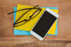 Close up view of smartphone and glasses Stock Photography