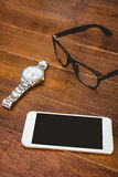 Close up view of smartphone and glasses Stock Image