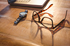 Close up view of smartphone and glasses Royalty Free Stock Photo