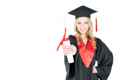 Close-up view of smiling student in graduation gown holding diploma Royalty Free Stock Photo