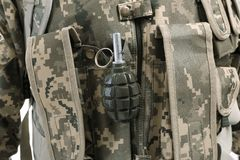 Close up view of soldier with  grenade Royalty Free Stock Photography