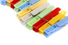 Colorful cloth pegs. Close up view of some colorful cloth pegs isolated on a white background stock photo