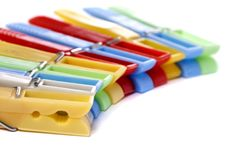 Colorful cloth pegs. Close up view of some colorful cloth pegs on a white background royalty free stock photo