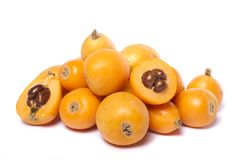 Loquat fruit. Close up view of some loquat fruit isolated on a white background Stock Images