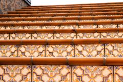 Close-up view of some steps of a Stairs with beautiful colorful. Ceramic tiles with pattern stock photo