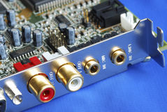 Close up view of a sound card. Isolated on blue Stock Images