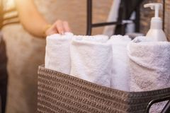 Close up view of spa theme objects on grey background. White Terry towels in basket stock photos