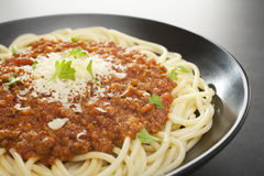 Spaghetti Bolognese with Parmesan on Dark Background Stock Photo