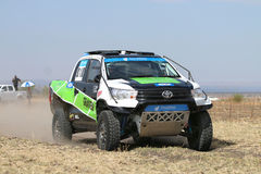 Close-up view of Speeding green and white Toyota Hilux twin cab Stock Images