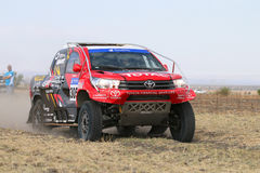 Close-up view of Speeding red and black Toyota Hilux twin cab ra Royalty Free Stock Image