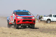 Close-up view of Speeding red and blue Toyota Hilux single cab r. Sun City, South Africa – OCTOBER 1, 2016: Forty Five degree close-up view of Speeding stock photography