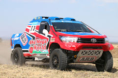 Close-up view of Speeding red and blue Toyota Hilux twin cab rally car. Sun City, South Africa – OCTOBER 1, 2016: Forty Five degree close-up view of stock photo