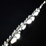 Close-up view of stadium spotlights glowing in the dark royalty free stock image