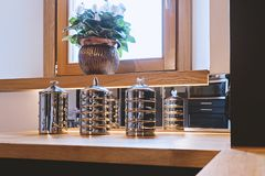 Close up view of stainless steel kitchen storage jars set. On shelf royalty free stock photo