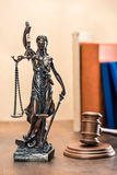 Close-up view of statue of lady justice and mallet. Law concept royalty free stock photography