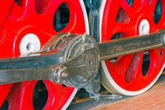 Close up view of steam locomotive wheels, drives, rods, links and other mechanical details. White, black and red colors. Close up view of steam locomotive Stock Images