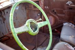 Steering wheel in old destroyed abandoned car royalty free stock photography