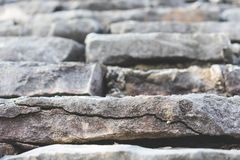 View of a rooftop of a traditional stone house with stone tiles, Istria, Croatia. Close up view of a stone tiled rooftop of a traditional stone house stock photography