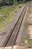 A close up view of a straight metal and concrete railway lines that is curving at the end stock photo