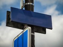 Close up view of street blue street sign. Empty label, badge stock photography