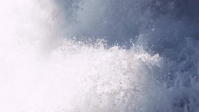 Close up view of strong sea water flow, in slow motion. No people around, cool atmosphere. stock video footage